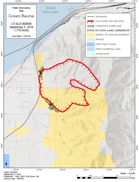Map showing the fire perimeter overlaid on a topographical map. The uncontained line is depicted in red.