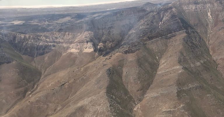 Aerial view of the Tabby Canyon Fire burning a ridge line.
