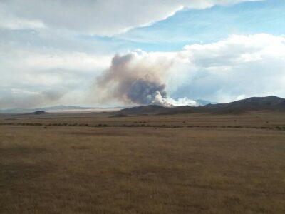 Far away view of smoke rising above the Rock Path Fire.
