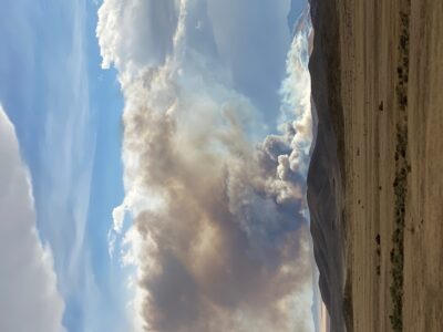 Image of smoke billowing up over a mountain.